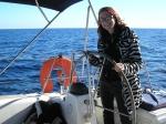 Niki steering a boat in Maltese seas